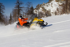 Athlete on a snowmobile Stock Photography