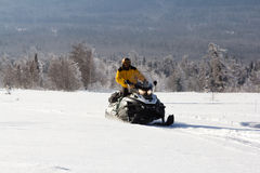 Athlete on a snowmobile Royalty Free Stock Images