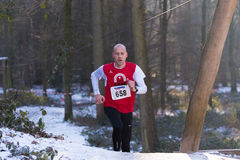 Athlete in a snowy forest Stock Photography