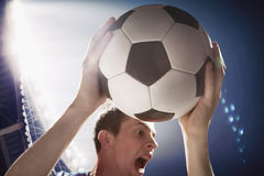 Athlete with soccer ball in stadium Royalty Free Stock Photography