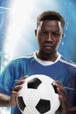 Athlete with soccer ball in stadium. Athlete with a soccer ball royalty free stock photography