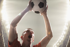 Athlete with soccer ball in stadium. Athlete with a soccer ball royalty free stock photos