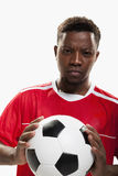 Athlete with a soccer ball royalty free stock photography