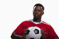 Athlete with soccer ball on white background. Athlete with a soccer ball stock photography