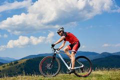 Athlete sportsman bicyclist in professional sportswear and helmet riding cross country bicycle royalty free stock photos