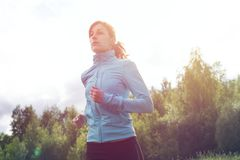 Athlete sportsmen girl running in morning sunrise Stock Photography
