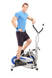 Athlete standing on a cross trainer machine Royalty Free Stock Image