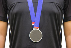 Athlete Standing With Gold Medals. Royalty Free Stock Photography
