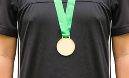 Athlete Standing With Gold Medals. Royalty Free Stock Photos