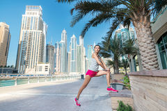 Athlete stands and makes the workout. Athletic woman in sportswe Stock Image