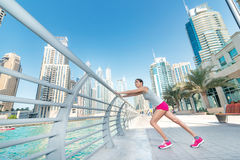 Athlete stands and makes the workout on the railing. Athletic wo Stock Images