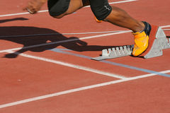 Athlete in start blocks Stock Image