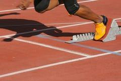 Athlete in start blocks. Jumping Stock Image