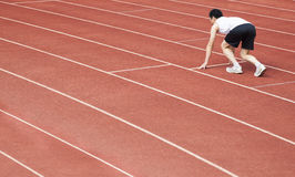 athlete  at the start of the line at the stadium Stock Images