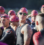 Athlete at the start of a triathlon. Stock Photos