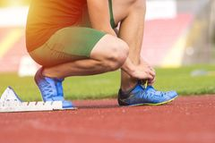 Athlete in the starting block waiting for the start in running track royalty free stock photography