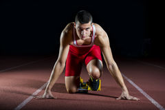 Athlete on the starting block. Young attractive athlete on the starting block Royalty Free Stock Photos
