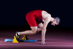 Athlete on the starting block Stock Photo