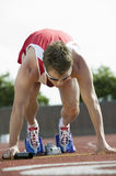 Athlete In Starting Blocks With Baton. Male athlete in starting blocks with baton Stock Photos