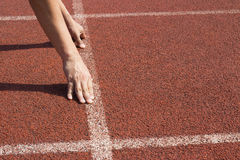 Athlete in the starting blocks, ready to go Royalty Free Stock Image