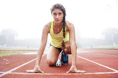 Athlete on the starting blocks Royalty Free Stock Photos