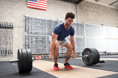 Athlete starting a deadlift in a crossfit gym Stock Photos