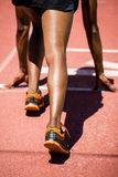 Athlete on a starting line about to run. On running track Royalty Free Stock Photos