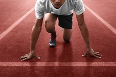 Athlete in starting position ready to running stock images