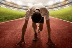 Athlete in starting position to race stock photo
