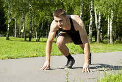 Athlete starts on the track Royalty Free Stock Photos