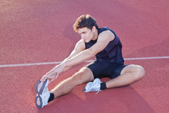 Athlete stretching. Royalty Free Stock Photography