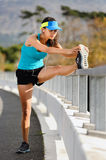 Athlete stretching Royalty Free Stock Photo