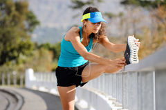 Athlete stretching Royalty Free Stock Photography