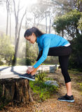 Athlete stretching outdoors Stock Images
