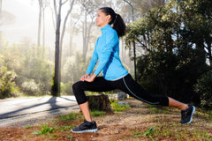 Athlete stretching outdoors Royalty Free Stock Image