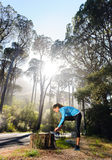 Athlete stretching outdoors Stock Photos