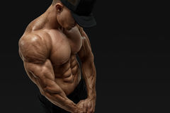 Athlete strong abs showing Royalty Free Stock Image