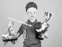 Athlete successful boy sport equipment jump rope boxing glove tennis racket roller skate and golden goblet. Success and. Award. Success in sport. Proud of royalty free stock image