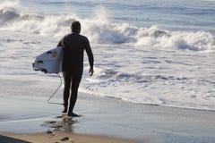Athlete surfing on Santa Cruz beach in California. Santa Cruz, USA, November 25, 2014: Athlete surfing on Santa Cruz beach in California. November 25, 2014 stock images