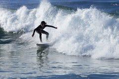Athlete surfing on Santa Cruz beach in California. Santa Cruz, USA, November 25, 2014: Athlete surfing on Santa Cruz beach in California. November 25, 2014 royalty free stock image