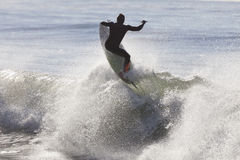 Athlete surfing on Santa Cruz beach in California. Santa Cruz, USA, November 25, 2014: Athlete surfing on Santa Cruz beach in California. November 25, 2014 royalty free stock photos