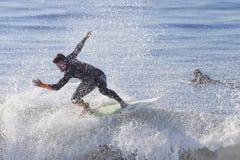 Athlete surfing on Santa Cruz beach in California. Santa Cruz, USA, November 25, 2014: Athlete surfing on Santa Cruz beach in California. November 25, 2014 royalty free stock photo