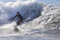 Athlete surfing on Santa Cruz beach in California. Santa Cruz, USA, November 25, 2014: Athlete surfing on Santa Cruz beach in California. November 25, 2014 royalty free stock images