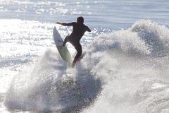 Athlete surfing on Santa Cruz beach in California Royalty Free Stock Photos