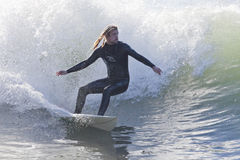 Athlete surfing on Santa Cruz beach in California Royalty Free Stock Photo