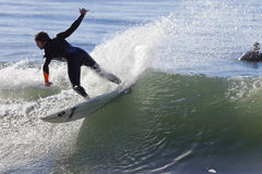 Athlete surfing on Santa Cruz beach in California Stock Photography