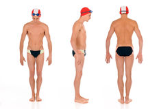 Athlete, swimmer. Young handsome male athlete, swimmer with goggles and swimming cap.  Studio shot.  Triple  shot, three start positions Royalty Free Stock Images