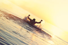 Athlete swimming in the water. At sunset Stock Photo