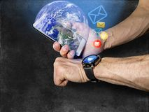 Athlete syncs your smartphone and smart watch on on your hand royalty free stock image