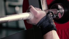 Athlete takes the Barbell in the Gym hand stock footage